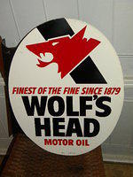 $OLD Wolfs Head Tin Flange Sign
