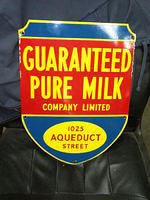 $OLD Guaranteed Pure Milk Porcelain Sign